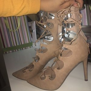 Nude strap up heels